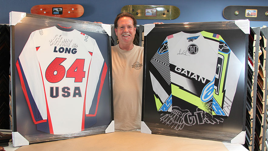 Autographed Jerseys Custom Framed This gentleman is updating his son's room and wanted to surprise him with these two autographed jerseys, so he had us do the custom framing. We stretched them lightly and framed them using a tall black frame and reflection control glass. The Dad loved how they turned out, and we have no doubt the son will too.