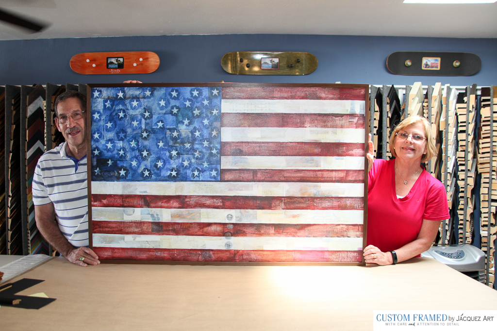 "U.S. Flag on Canvas - Stretched and Custom Framed Here's our latest custom framed project for this beautiful couple. We started with a rolled up Canvas Art of a U.S. Flag by the Artist Allan Tuttle. The Flag measured 54"" x 35"" and once stretched, we used a medium wood-tone frame to to put final touches. The customers loved it!"