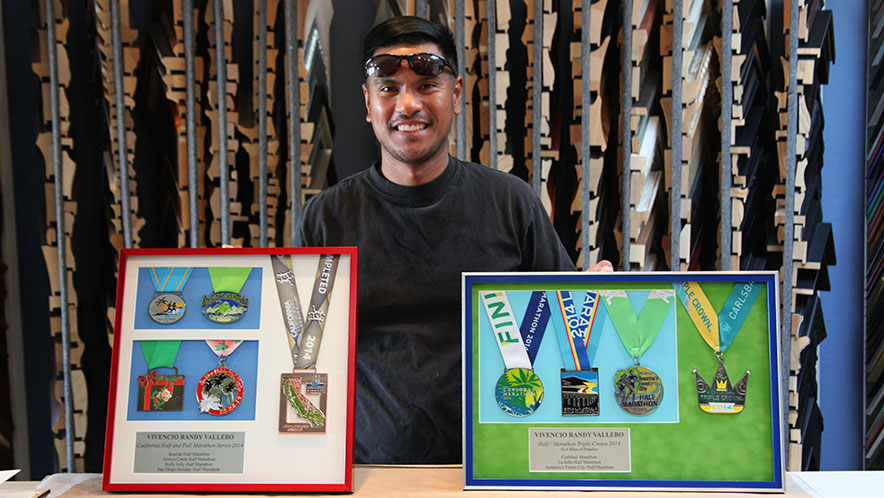 Marathon Medals Custom Framed We worked closely with this amazing athlete to make sure we did justice to all of his achievements as a marathon runner. We build two frames for two separate marathons, both with metal frames, double mats and anti-glare glass. He loved them when we did the unveiling at the store.