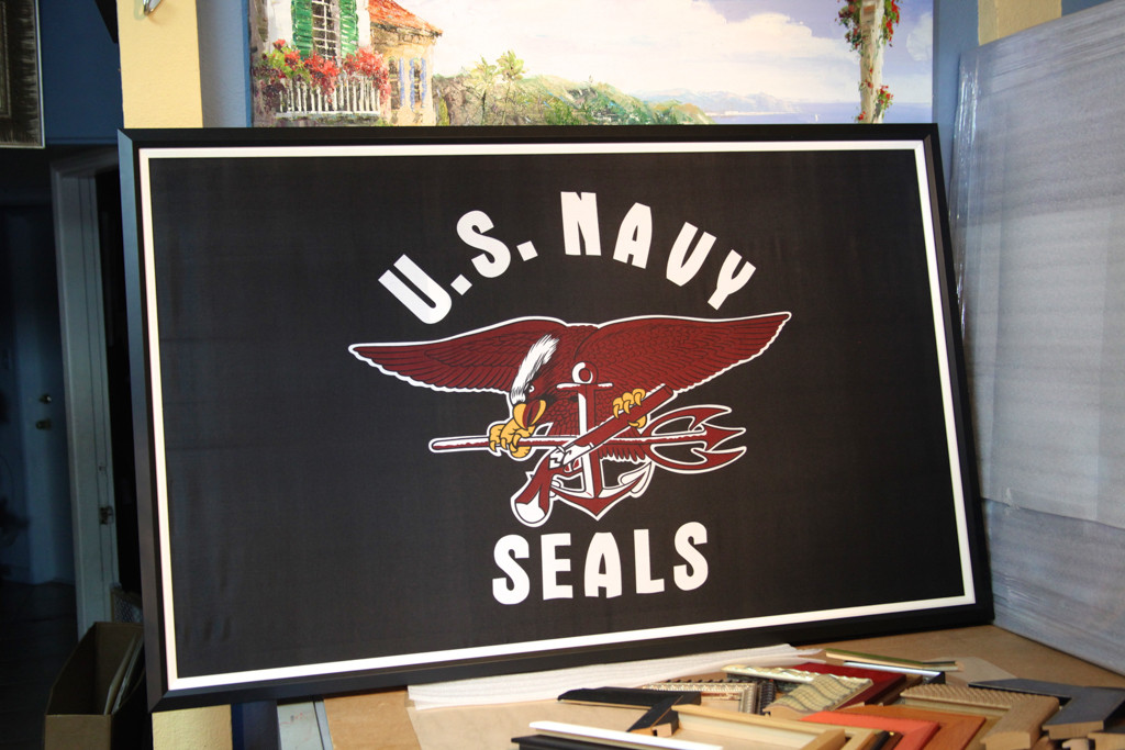 U.S. Navy Seals Flag that we stretched and Custom Frame for one of our customers. She loved how it turned out!