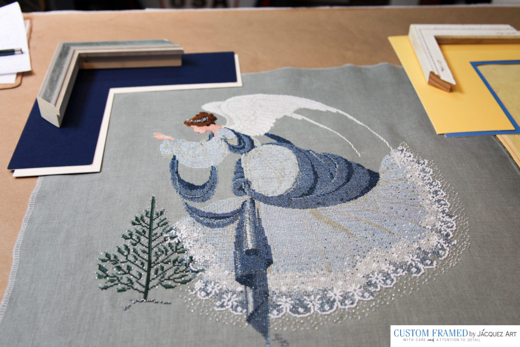 BEFORE: We also do needlework stretching as in this beautiful embroidery artwork.