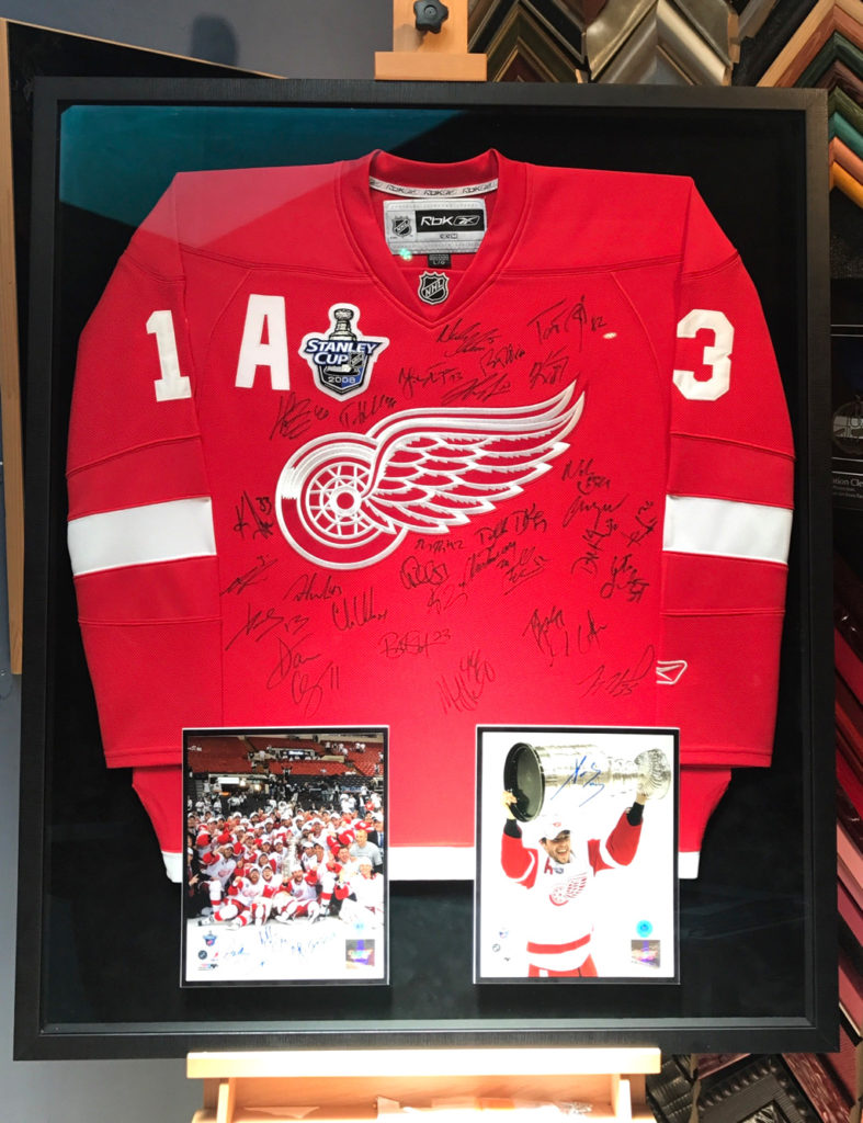 Detroit Red Wings Hockey Jersey signed by the Team and Framed by Jacquez Art